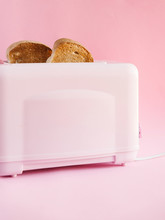 Toaster With Bread Slices On P...