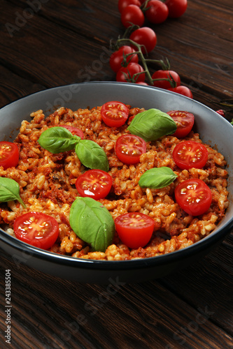 risotto with tomatoes, fresh herbs and parmesan cheese.