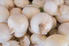 High Angle View Of White Onions For Sale At Market