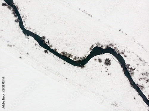 Pinturas sobre lienzo  Aerial view of river bed, top view. Nature in winter