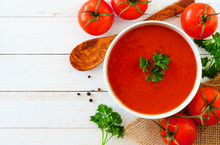 Homemade Tomato Soup. Above View, Side Border With Copy Space On A White Wood Background.