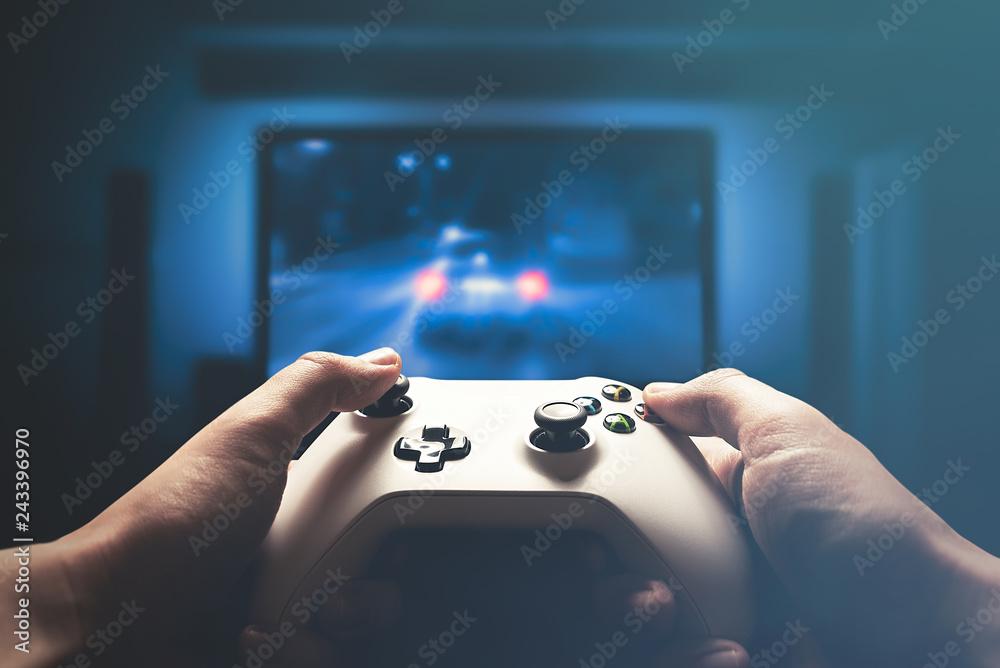 Fototapeta Video gaming console. Man playing car racing
