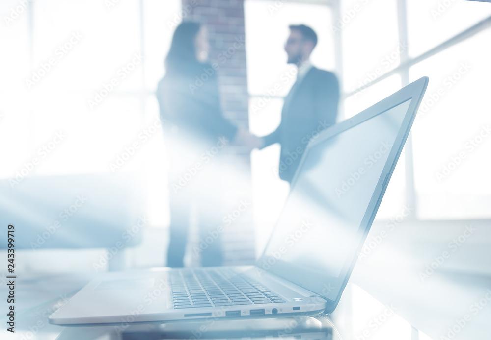 Fototapety, obrazy: laptop on the desk, background handshake