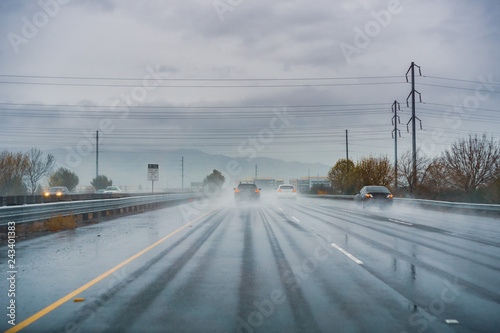 Fotografie, Obraz  Driving on the highway on a rainy day with low visibility; wet pavement; south S