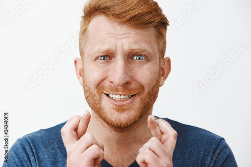 Photographie  Headshot of nervous panicking good-looking male with ginger hair and bristle, fr