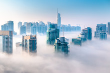 Aerial View Of Skyscrapers In The Clouds. Morning Winter Fog Over Dubai Marina. City Above The Clouds