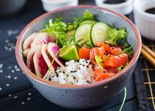 Hawaiian Salmon Fish Poke Bowl With Rice, Cucumber, Radish, Sesame Seeds And Lime. Buddha Bowl. Diet Food.