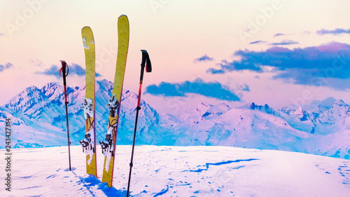Ski in winter season, mountains and ski touring backcountry equipments on the top of snowy mountains in sunny day, Verbier Switzerland.