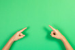 canvas print picture - Children hands pointing on pastel green background