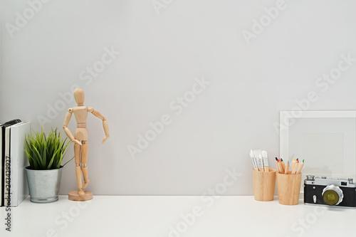 Fototapeta Minimalist stylish workspace poster, home office supplies, vintage camera and copy space obraz na płótnie