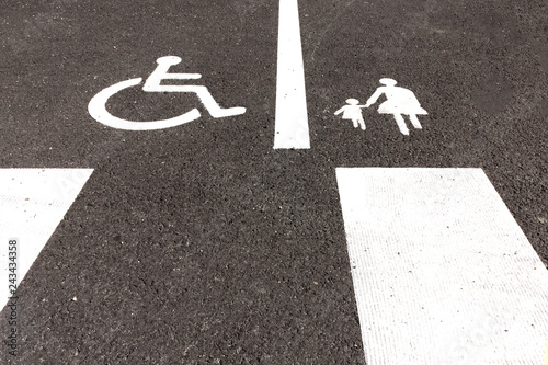 Fotografia, Obraz  Handicap and Mother with child parking signs on asphalt.