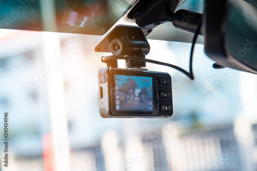 Photo Car video camera attached to the windshield to record driving and prevent danger