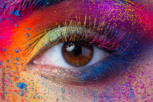 Papiers peints Macro photographie Close up view of female eye with bright multicolored fashion makeup. Holi indian color festival inspired. Studio macro shot