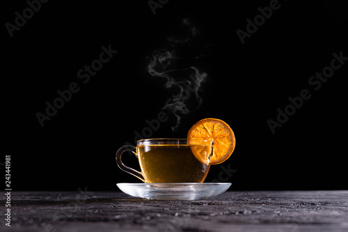 Recess Fitting Tea Steamy Hot Herbal Tea on Black Background