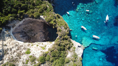 In de dag Blauwe jeans Aerial drone bird's eye view photo of sail boats docked in tropical caribbean paradise bay with white rock caves and turquoise clear sea