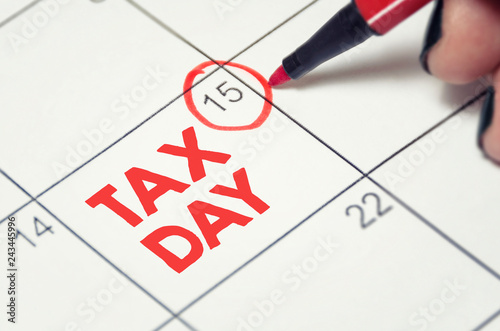 Tax day concept. The USA tax due date marked on the calendar. © adzicnatasa