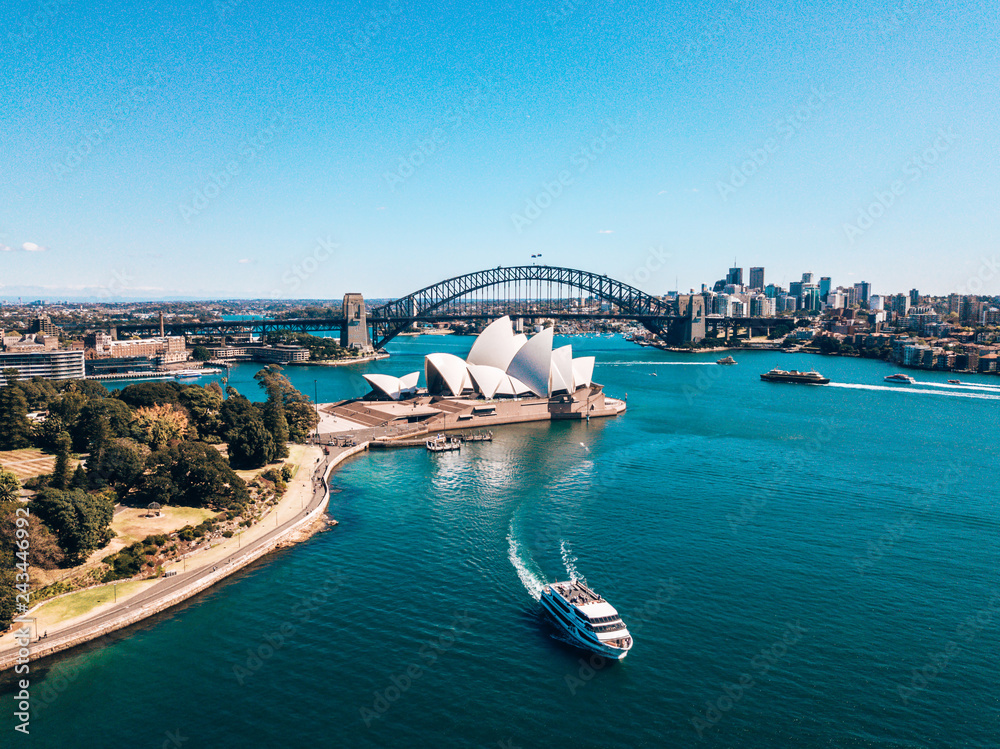Fototapeta January 10, 2019. Sydney, Australia. Landscape aerial view of Sydney Opera house near Sydney business center around the harbour.