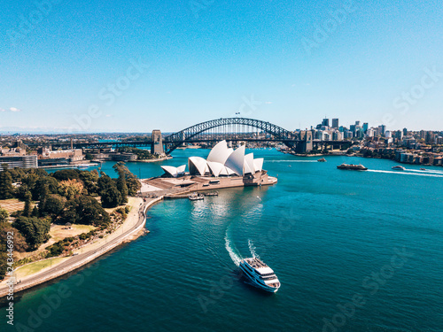 Photo Stands Sydney January 10, 2019. Sydney, Australia. Landscape aerial view of Sydney Opera house near Sydney business center around the harbour.