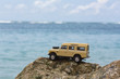 Toy 4x4 Offroad vehicle drives at the beach