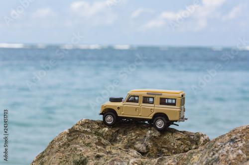 Toy 4x4 Offroad vehicle drives at the beach Canvas Print