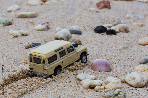 Toy 4x4 Offroad vehicle drives at the beach Wallpaper Mural