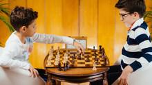 School Boys Playing Chess