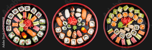 Photo Stands Sushi bar Sushi Set nigiri, rolls and sashimi served in traditional Japan black Sushioke round plate. On dark background