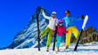 Leinwandbild Motiv Happy family enjoying winter vacations in mountains . Ski, Sun, Snow and fun.