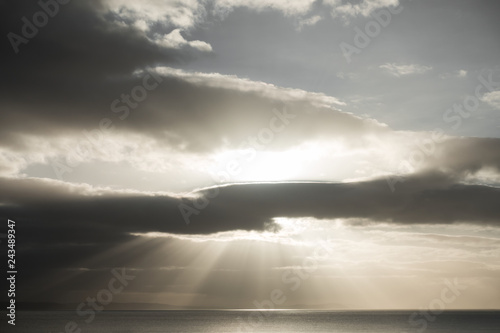 066aea09def36 Bright Sun and Sun Rays Shining through Dark Clouds - Buy this stock ...