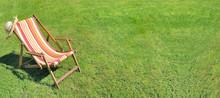 Deckchair On Greenery Grass In...