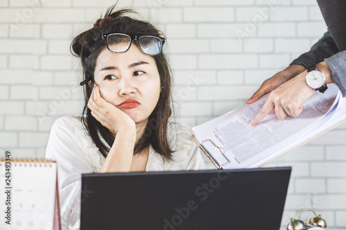 tired and bored female Asian employee ignore annoying boss at office desk Canvas Print