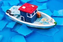 Little Model Fishing Boat In Water
