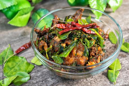 Fotografie, Obraz  Spicy Stir Fried catfish with spicy Thai herbs food, Thai food name phad phed pla duk thod krob