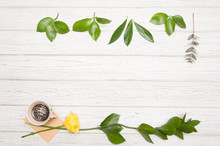 Bright Background With Green Leaves, Yellow Rose, Cup Of Coffee And Small Envelope, Flat Lay, Copy Space