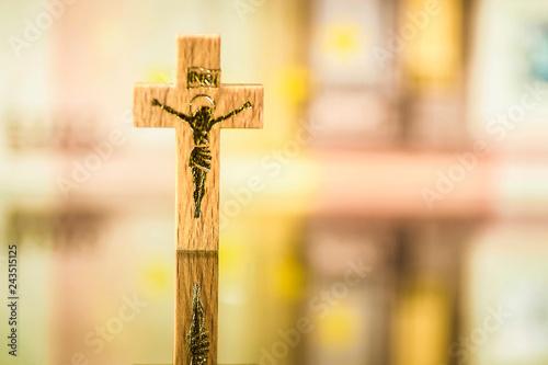 Fotografie, Obraz  Crucifix against a fuzzy euro banknote