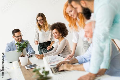 Fotografiet  Joyful multiracial business team at work in modern office