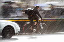 Cyclist On A City Street At He...