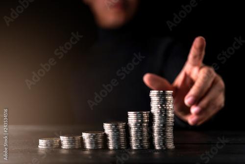 Fototapeta business financial ideas concept businessman hand point money coin stair stack black background obraz