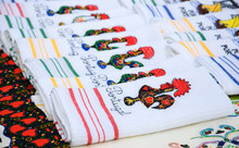 Souvenir Towels With Embroidery Of The Galo De Barcelos (Barcelos Rooster) -  Traditional Symbol Of Portugal - At The Street Market In Porto (Portugal). Selective Focus On The Closest Towels.