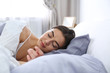 Young woman sleeping on soft pillow. Bedtime