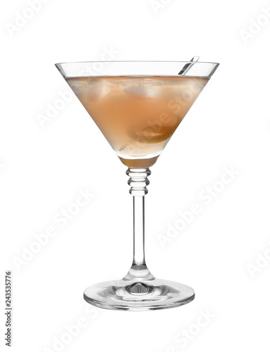Glass of martini cocktail with ice cubes and lemon zest on white background