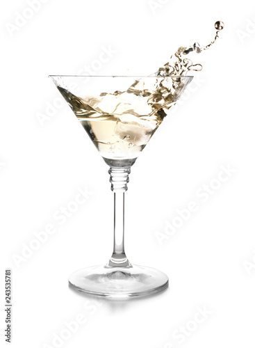 Glass of classic martini with splash on white background