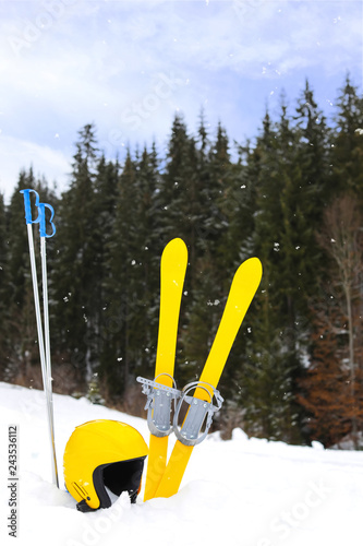 Ski equipment in snow outdoors. Winter vacation