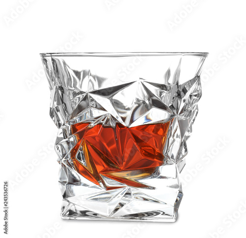 Glass of scotch whiskey on white background