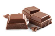 Pieces Of Tasty Milk Chocolate On White Background