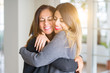 canvas print picture - Beautiful family of mother and daughter together, hugging and kissing at home
