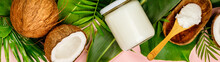 Coconut Oil, Tropical Leaves And Fresh Coconuts