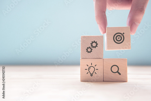 Fotografía Businessman hand arranging wood block with icon business strategy and Action plan, copy space