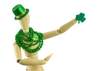Isolated St Patrick's Day Mannequin With A Shamrock Heart Green Glitter Hat And Holding Another Shamrock