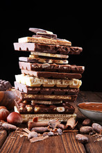 Chocolate Bars On Table With Chocolate Tower.